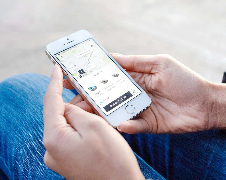 Rider using Uber app on smartphone
