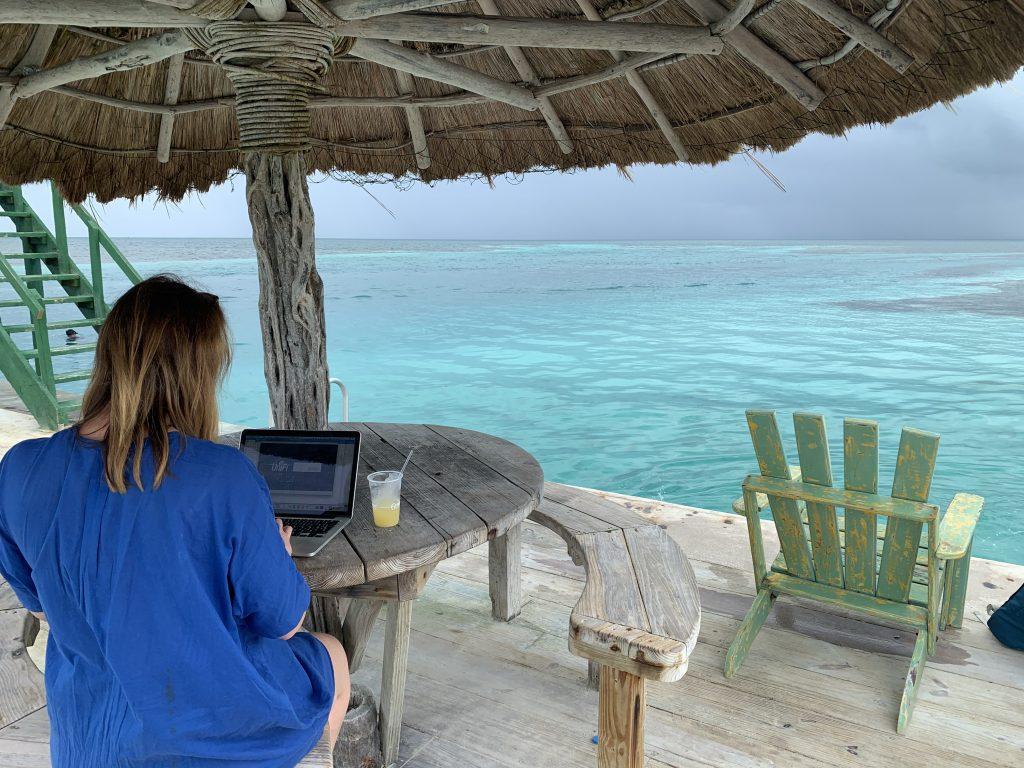 Aurélie Krau, expert in Gen Z, Millennials and business travel showing her digital nomad lifestyle in Belize.