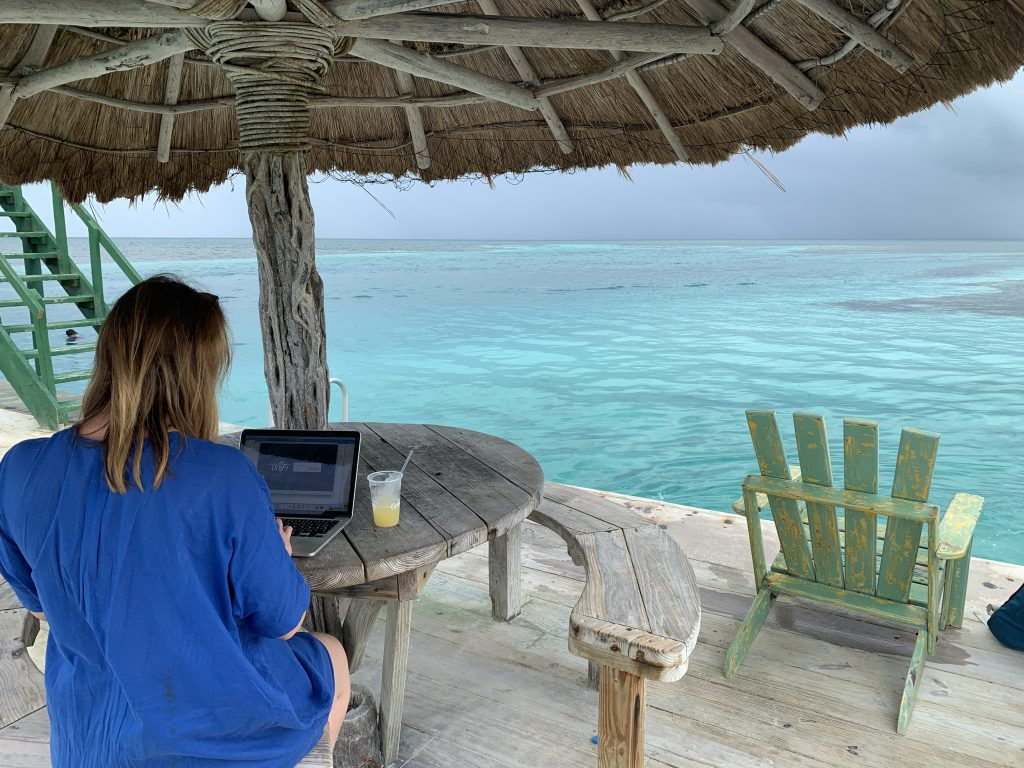 Aurélie Krau, expert in Gen Z, Millennials and business travel showing her digital nomad lifestyle in Belize.