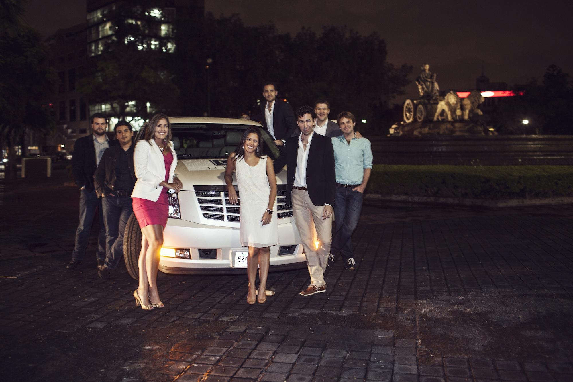 Uber Team w_ Escalade and Fountain